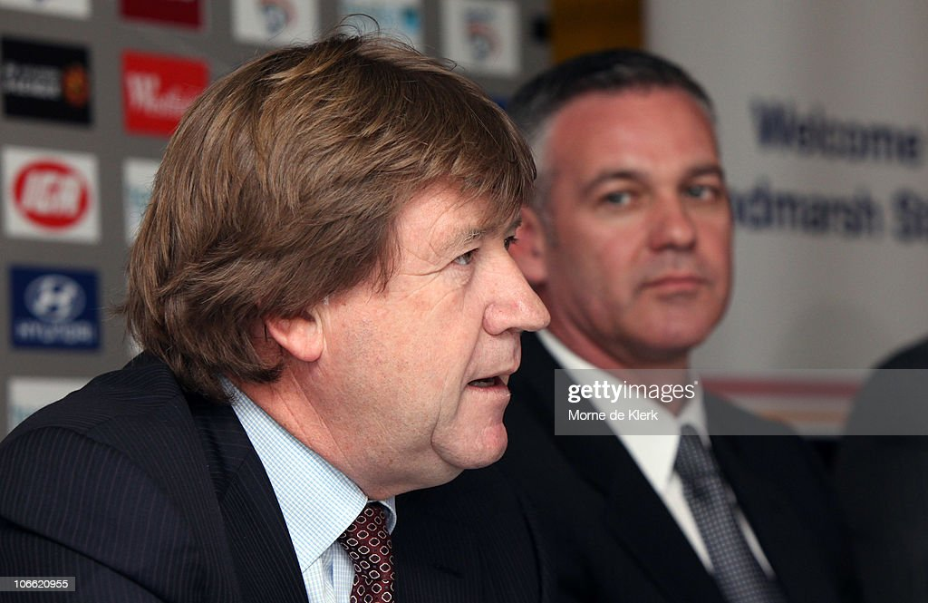 New club chairman, Greg Griffin speaks as Football Federation Australia CEO Ben Buckley listens during a media conference announcing the new owners of the Adelaide United Football Club at Hindmarsh Stadium on November 8, 2010 in Adelaide, Australia.