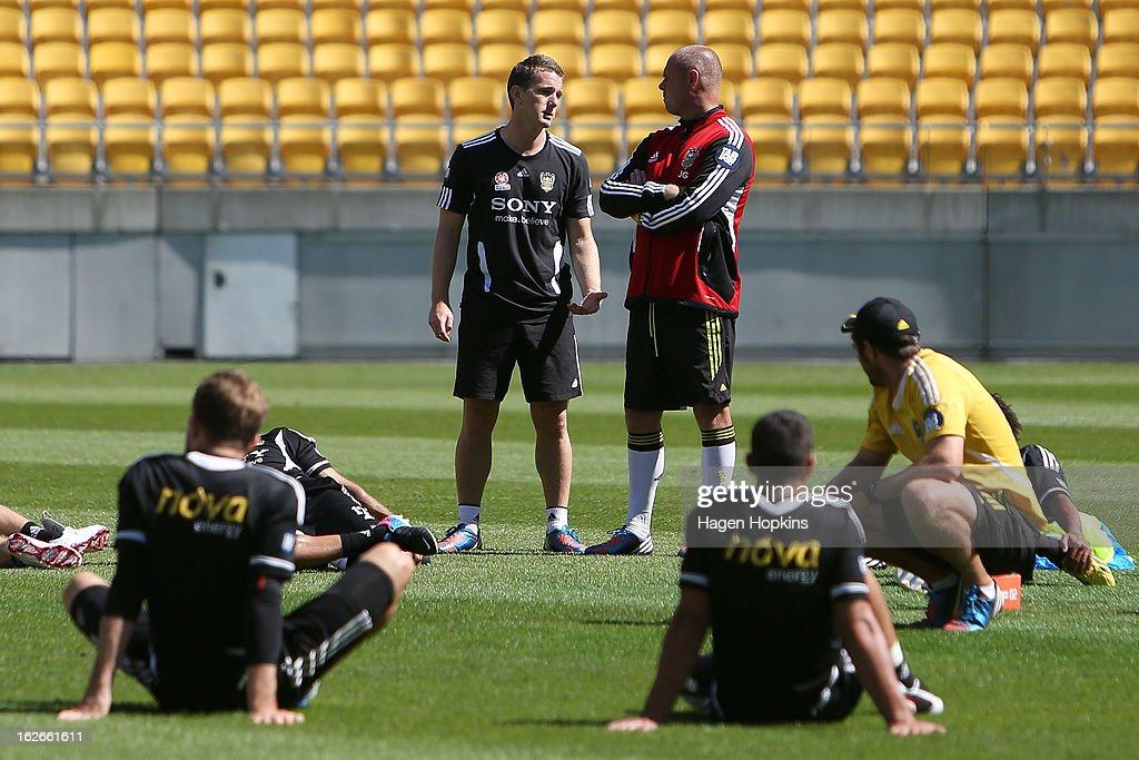 New coach Chris Greenacre (L) and goalkeeping coach Jonathan Gould talk during a Wellington Phoenix A-League training session at Westpac Stadium on February 26, 2013 in Wellington, New Zealand.