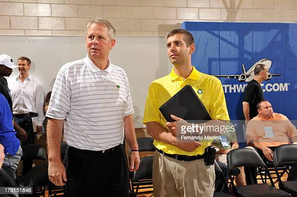 New coach of Boston Celtics Brad Stevens confers with Daniel Ray 'Danny' Ainge basketball executive President of Basketball Operations for the Boston...