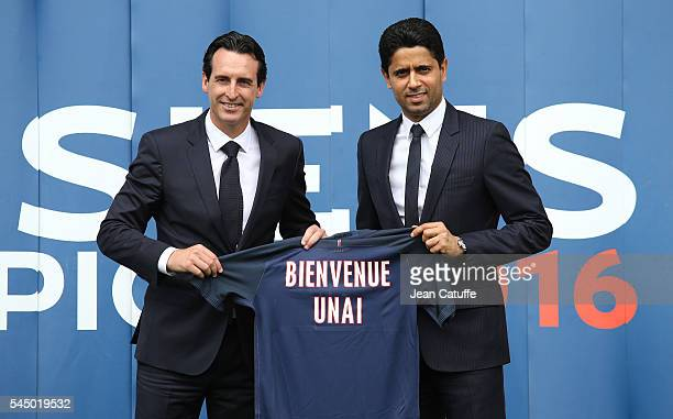 New coach of French Ligue 1 football club Paris SaintGermain Unai Emery of Spain has his jersey presented by President of PSG Nasser AlKhelaifi at...