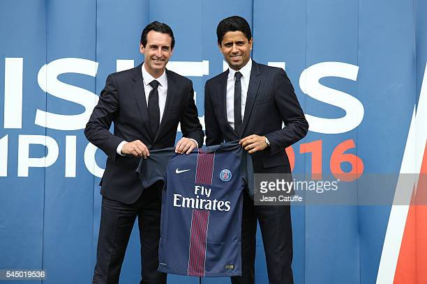 New coach of French Ligue 1 football club Paris SaintGermain Unai Emery of Spain has his jersey presented by President of PSG Nasser AlKhelaïfi at...