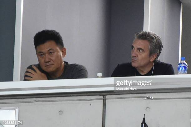 New coach of Vissel Kobe, Juan Manuel Lillo and Vissel Kobe chairman Hiroshi Mikitani look on prior to the J.League J1 match between Urawa Red...