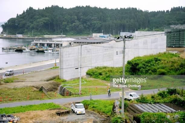 New coastal levee surrounding Asabe Fish Port is under construction on September 6 2017 in Rikuzentakata Iwate Japan