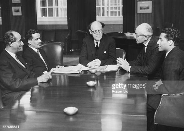 New Colonial Secretary Frank Pakenham Lord Longford chairs talks around a table between representatives of Aden and Colonial Ministers Seyyid Ahmed...