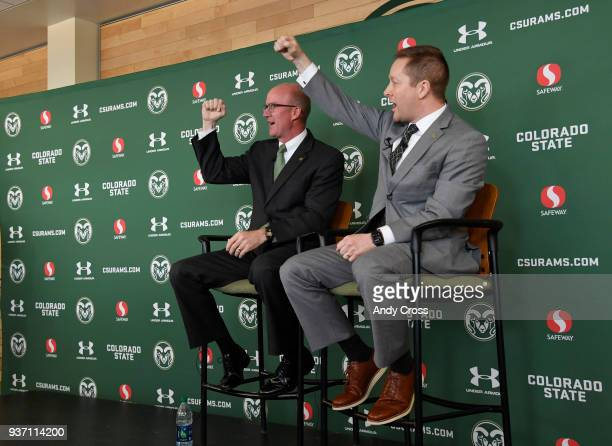 New Colorado State University men's basketball coach Niko Medved right and CSU athletic director Joe Parker lead the crowd in the CSU fight song...