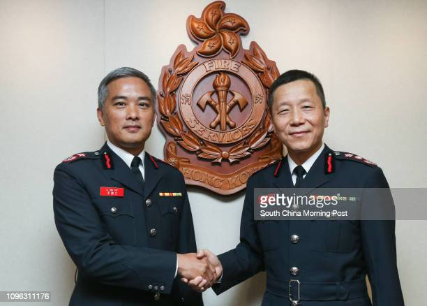 New coming Fire Services Department Director Li Kinyat and director David Lai Manhin shake hands during a media teagathering to farewell Lai at Fire...