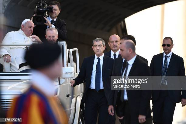New Commander of the Vatican Gendarmerie, Gianluca Gauzzi Broccoletti escorts the Popemobile car as Pope Francis arrives for the weekly general...