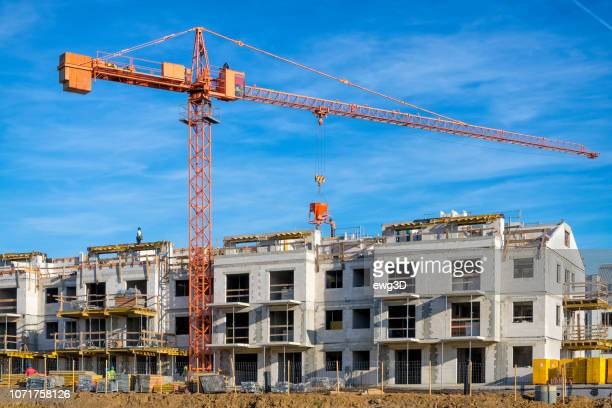 new complex of apartment buildings under construction - council flat stock pictures, royalty-free photos & images