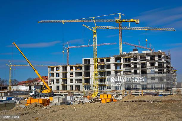 new condominium building under construction - crane construction machinery stock pictures, royalty-free photos & images