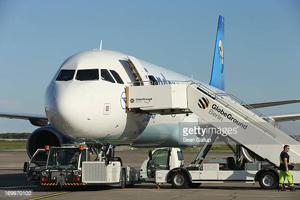 A new Condor airlines Airbus A321 stands on the tarmac on the day of its christening at Schoenefeld Airport on June 5 2013 in Schoenefeld Germany...