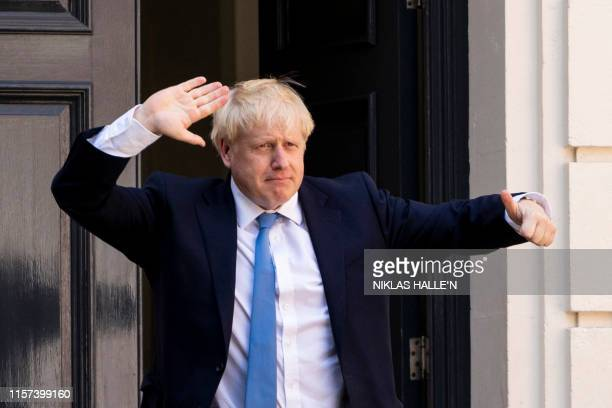 TOPSHOT New Conservative Party leader and incoming prime minister Boris Johnson arrives at the Conservative party headquarters in central London on...