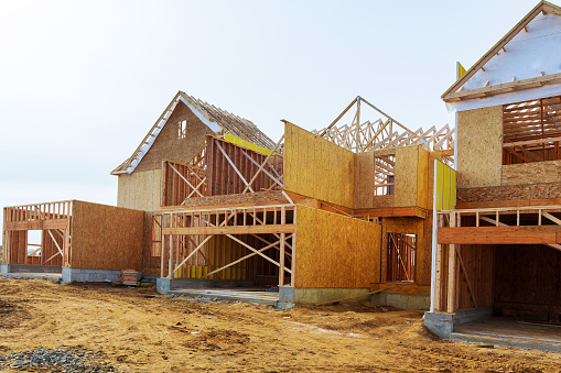 New construction of a house Framed New Construction of a House Building a new house from the ground up 888977462