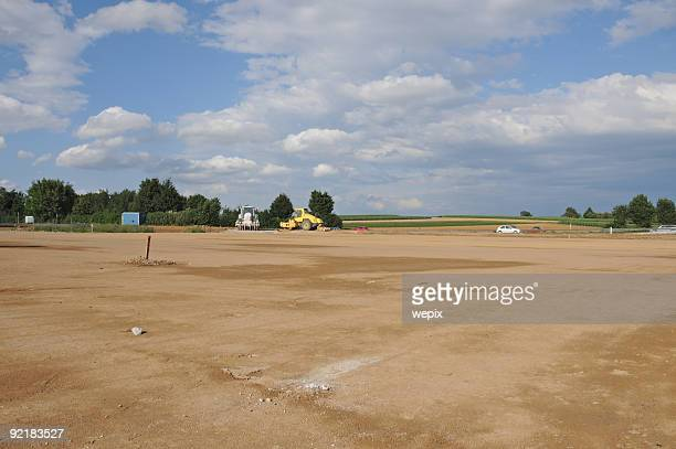 New construction site empty levelled ground farmland soil sealing