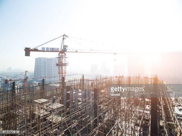 new construction site in midtown of modern city - crane stock pictures, royalty-free photos & images