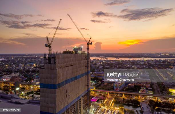 new construction site near river curve at sunset - south east asia stock pictures, royalty-free photos & images