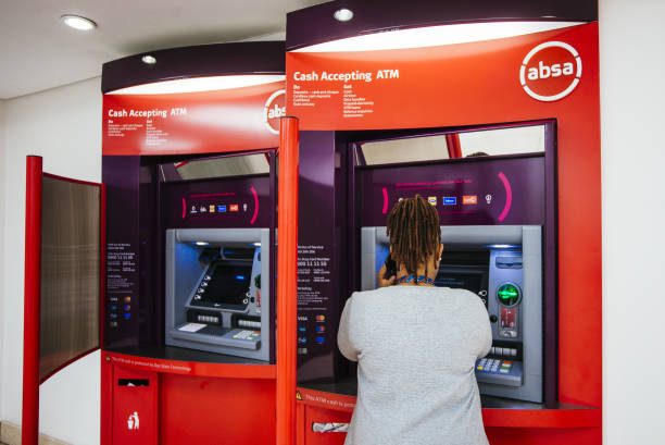new corporate logo sits above an automated teller machine at an absa picture
