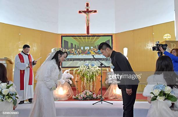 A new couple are celebrating their wedding in a Catholic church in Xiangyang Hubei China on 6th December 2014