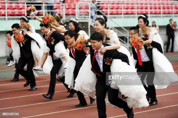 New couples attend a PhD students' group wedding at Harbin Institute of Technology on June 4 2017 in Harbin Heilongjiang Province of China Harbin...