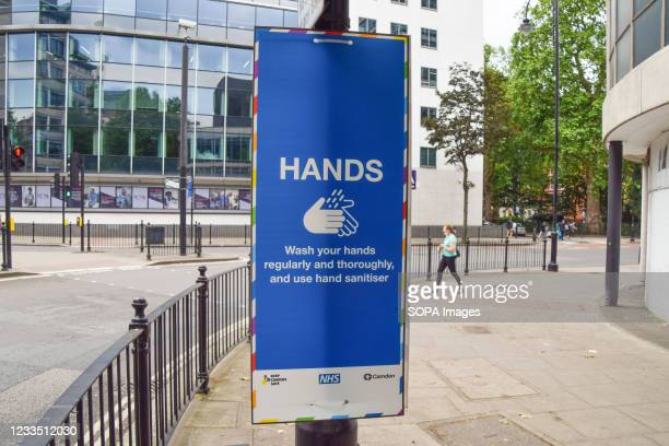 New COVID-19 sign with advice on washing hands seen in Central London. England is seeing a huge rise in coronavirus cases, which scientists say is...