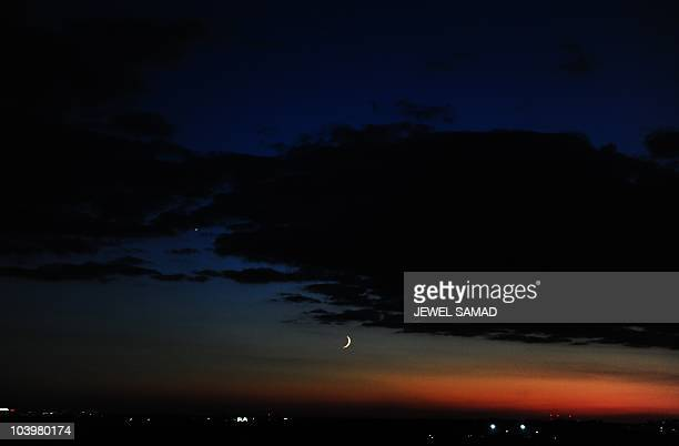 A new crescent moon is seen in the sky from Silver Spring Maryland on September 10 2010 as Muslims in US celebrate EidalFitr which marks the end of...