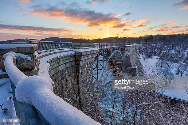 new croton dam during sunrise in the winter covered with snow. - westchester county stock pictures, royalty-free photos & images