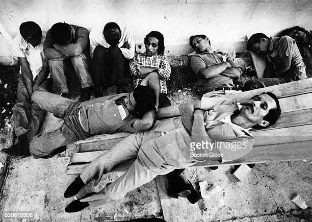 New Cuban refugees nap at the Trumbo Point naval station in Key West, Fla., where they are being processed before being bused to the Key West Airport...