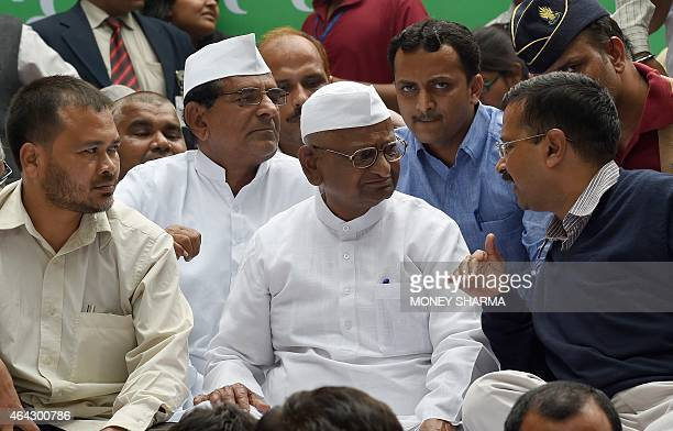 New Delhi chief minister Arvind Kejriwal talks with Indian anticorruption activist Anna Hazare during a protest in New Delhi on February 24 2015...