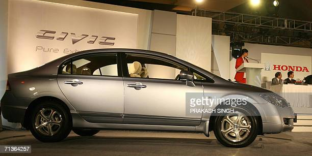 Honda Civic car is on display during a promotion in New Delhi, 04 July 2006. Honda Civic has an advanced 1.8 L i-VTEC engine. Civic is available in...