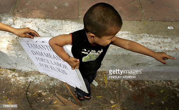 A young member of the Ethnic minority Kuki people holds a placard during a demonstration against the construction of the Thamanti Dam in New Delhi 16...
