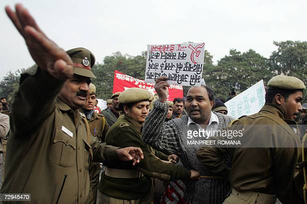 An activist of The Communist Party of India CPI waves a placard as he takes part in a protest in New Delhi 08 January 2007 against the death of...