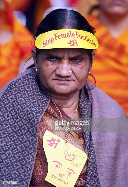 An elderly Indian woman listens to a speaker during a rally held against 'female foeticide' in New Delhi 10 December 2006 Fresh statistics show that...