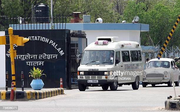 An Indian Army ambulance carrying Indian External Affairs Minister Pranab Mukherjee drives away from Palam Air Force station in New Delhi 08 April...