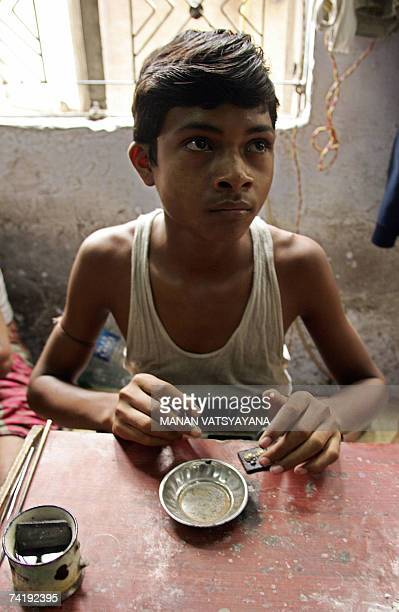 An Indian child labourer works at an embroidery and jewelery workshop in New Delhi, 19 May 2007. Around 60 children were rescued from factory units...
