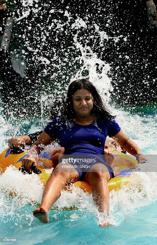 An indian girl enjoys a ride in a water pictures getty images an indian girl enjoys a ride in a water park at appu ghar in new delhi thecheapjerseys Image collections