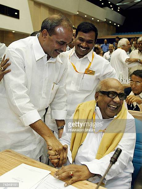 Andhra Pradesh Chief Minister Rajshekhar Reddy shakes hands with Tamil Nadu Chief Minister M Karunanidhi during the 53rd meeting of the National...