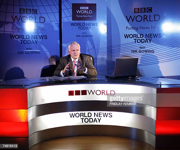 World presenter Nik Gowing gestures as he addresses media representatives at a presentation in New Delhi, 26 June 2007. Gowing who has worked for the...