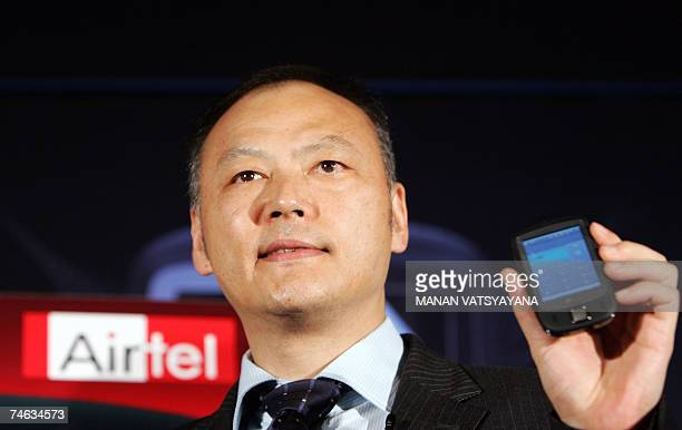 Chief Executive Officer of High Tech Computer Peter Chou poses with the newly launched HTC touch mobile phone in New Delhi 15 June 2007 The HTC touch...