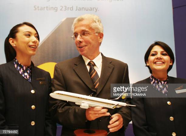 Chief Executive Officer of Jet Airways Wolfgang ProckSchauer chats with air hostesses during a press conference in New Delhi 11 December 2006 Jet...