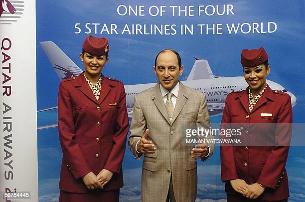 Chief Executive Officer Qatar Airways Akbar Al Baker accompnaied by air hostesses addresses media persons during a conference in New Delhi 06...