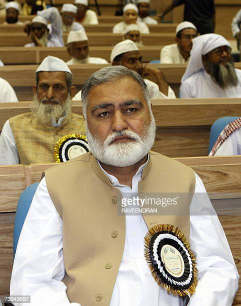 Chief Minister of Pakistan's North West Frontier Province Akram Khan Durrani sits with other delegates as he attends a Fidaemillat Seminar organized...