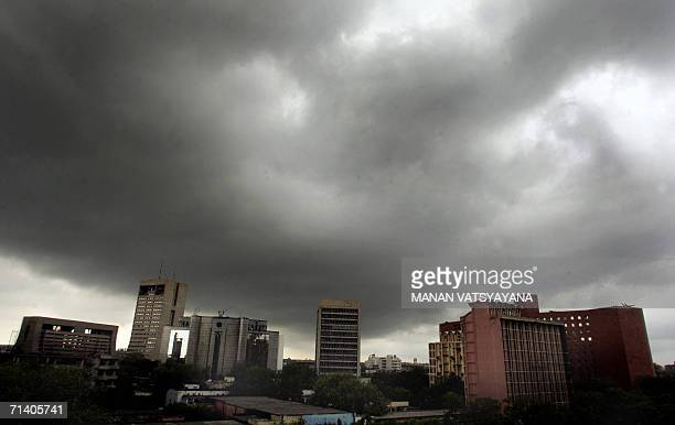 Dark cloud covers the skyline of New Delhi 10 July 2006 The Indian capital experienced its first monsoon showers 09 July bringing relief from hot and...