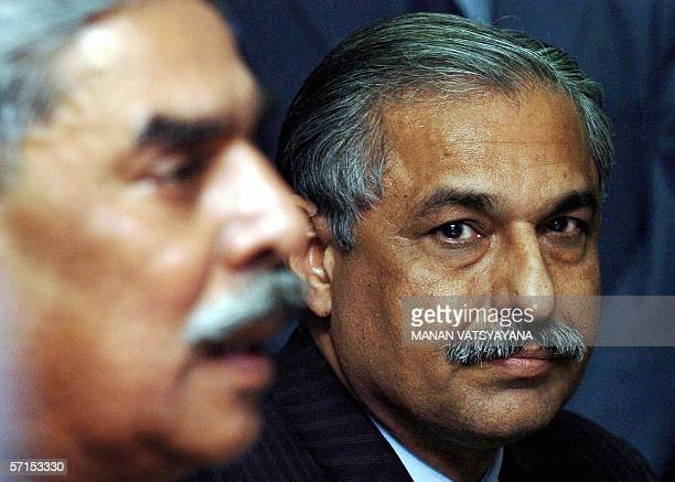 Director General of the Federal Investigation Agency of Pakistan Tariq Parvez looks on as Indian Director of the Central Bureau of Investigation...