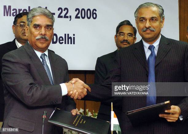 Director General of the Federal Investigation Agency of Pakistan Tariq Parvez shakes hands with Indian Director of the Central Bureau of...