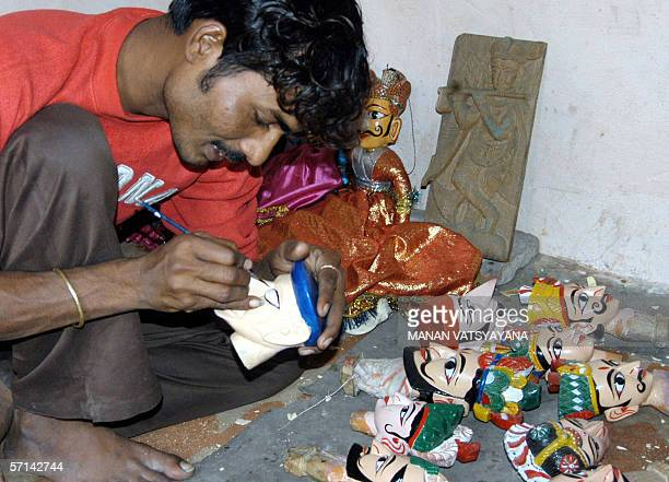 FEATUREWORLD PUPPETRY DAY03/08 In this photograph taken 14 February 2005 an Indian puppeteer works at his workshop in New Delhi February 2005...