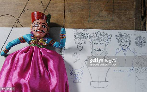 FEATUREWORLD PUPPETRY DAY04/08 In this photograph taken 14 February 2005 an unfinished puppet is pictured with a rough drawing of the puppets at an...