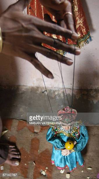 FEATUREWORLD PUPPETRY DAY06/08 In this photograph taken 14 February 2005 a puppet dances at an Indian puppeteer's workshop in New Delhi Puppetry a...