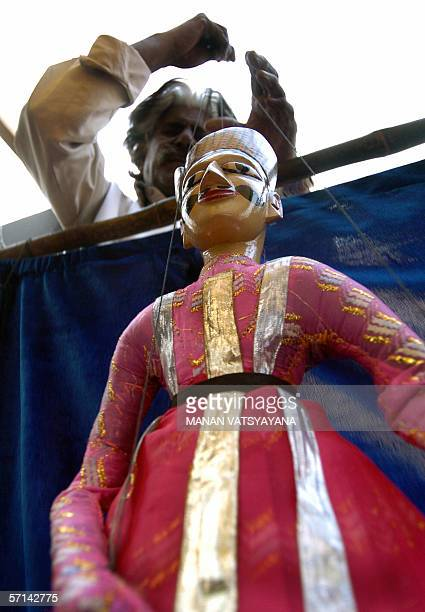 FEATUREWORLD PUPPETRY DAY07/08 In this photograph taken 21 November 2005 an Indian puppeteer performs at a puppetshow in New Delhi Puppetry a...