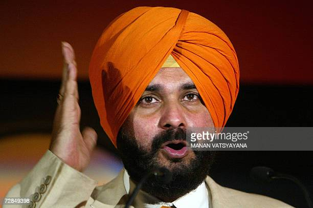 Former Indian cricketer Navjot Singh Sidhu gestures during the launch of an online Mutliplayer cricket game in New Delhi 19 December 2006 Sidhu a...