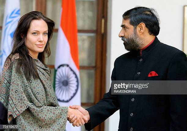 Hollywood film actress and UNHCR goodwill ambassador Angelina Jolie shakes hands with the Indian Minister of State for External Affairs Anand Sharma...