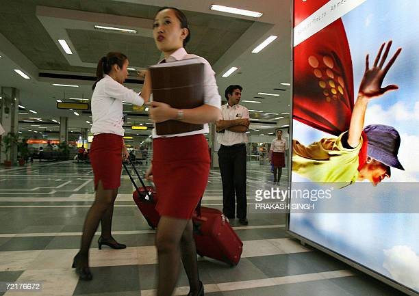 In this photograph dated 02 June 2006 Indian AirHostesses with lowcost Domestic Airline 'Spicejet' arrive at the domestic terminal of Indira Gandhi...